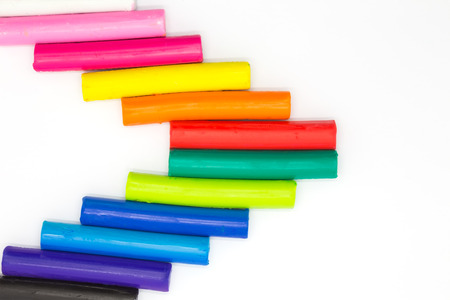 clay craft: Rainbow colours clay sticks on white background,  childrens education craft product
