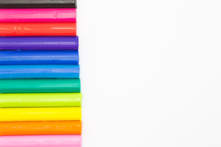 clays: Colors childrens clays sticks on a white background