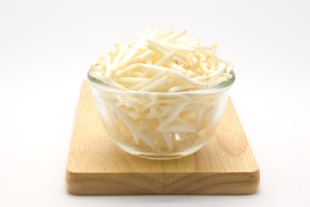 bean sprouts: Glass bowl of bean sprouts on wooden board, white background