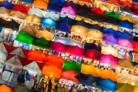 fleamarket: Abstract blurred bokeh lights background, Close up multiple colours umbrella of weekend market,