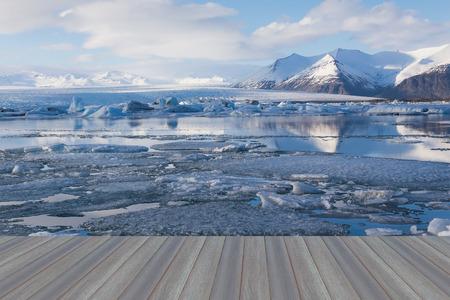 jokulsarlon: Opening wooden floor, Jokulsarlon ice melting lake during late winter, Iceland Stock Photo