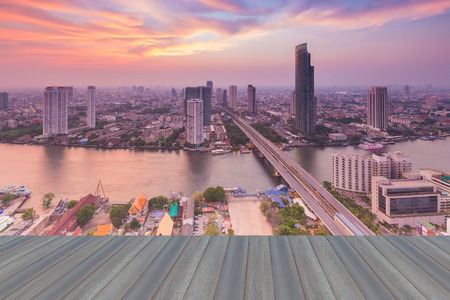 natual: Opeing wooden floor, after sunset of Bangkok skylines with Chao Phraya river curve, Bangkok Thailand
