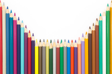 mixed colors: Line of mixed colors wooden pencils on white background