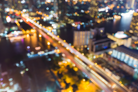 bridged: Abstract blurred lights city bridged cross river at night