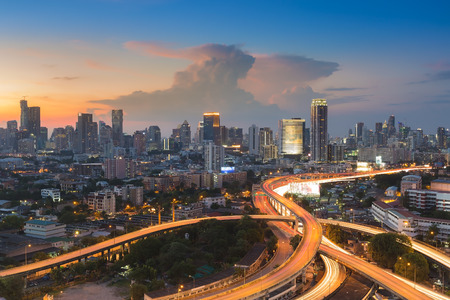 Sunset of Cityscape with highway interchange overpass during busy hour