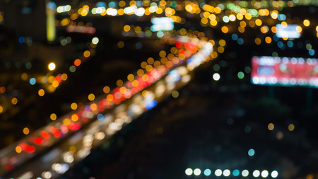 dallas: Abstract blurred bokeh lights, aerial view of city road curved at night