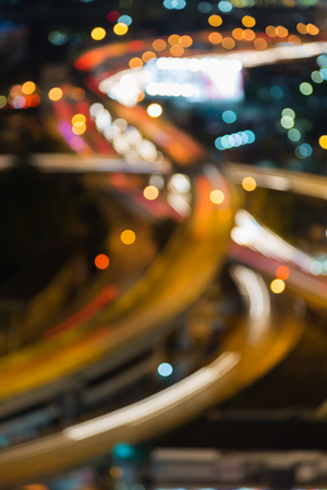 night highway: Abstract blurred bokeh lights at night, highway interchange aerial view Stock Photo