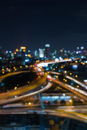 interchanged: Night view blurred bokeh light city road interchanged Stock Photo