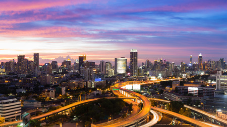 interchanged: Aerial view city downtown and highway interchanged with beautiful sky during twilight