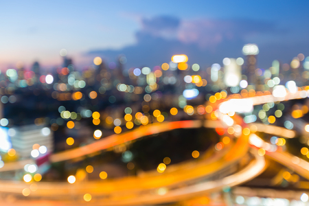 interchanged: Blurred bokeh city downtown highway interchanged after sunset