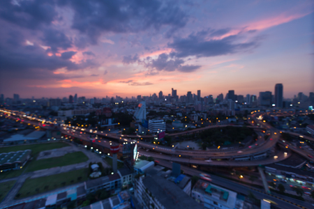 highway interchange: Blurred light of Bangkok city downtown with main highway interchange during sunset Stock Photo