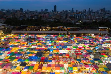 fleamarket: Twilight multiple colour city weekend market aerial view