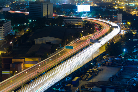 express lane: Aerial view city highway road curved at night Stock Photo