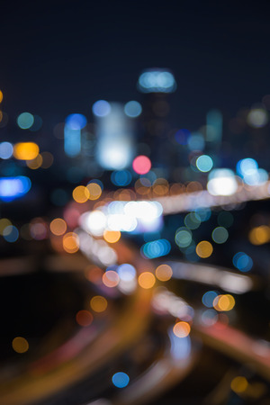 interchanged: Blurred bokeh light city and interchanged road at night