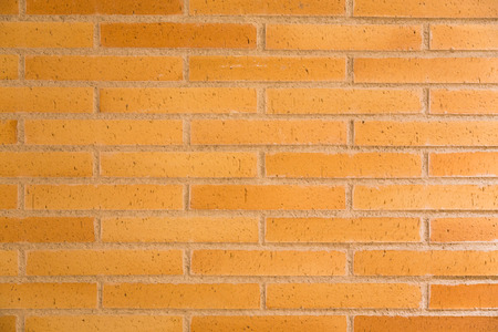 solidity: Yellow bricks wall background and texture Stock Photo