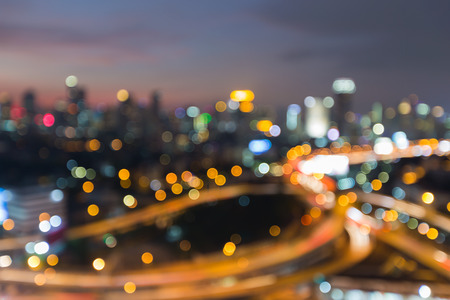 interchanged: Abstract blurred bokeh light, city road interchanged with office building background at night Stock Photo