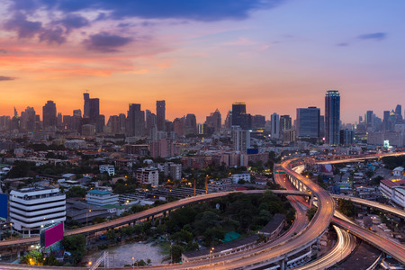 interchanged: Skyline of city road interchanged and downtown background during sunset