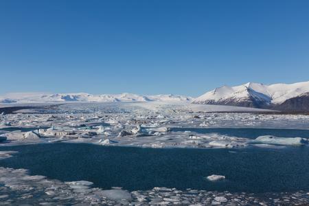 glacial: Jokulsarlon, Glacial lake with icebergs and mountain background, Iceland Stock Photo