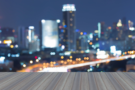 interchanged: Opening wooden floor, Abstract blurred bokeh light, city road interchanged with office building background at night