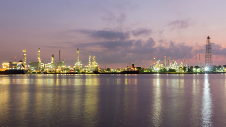 refinement: Oil refinery along with river before sunrise, Bangkok Thailand