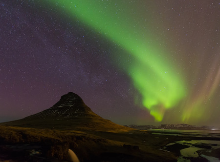 auroral: Northern lights or Aurora dancing with fully of stars on the sky of Iceland mountain landscape. Stock Photo