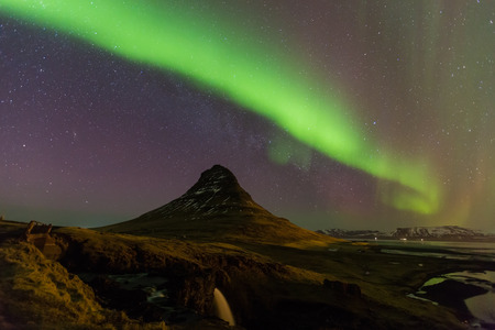 geomagnetic: Beautiful aurora dancing with fully of stars on the sky of Iceland mountain landscape. Stock Photo
