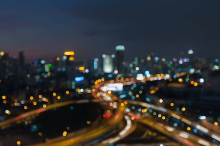 interchanged: Blurred bokeh lights, aerial view city road interchanged and downtown background