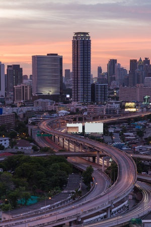 interchanged: Aerial view of city and expressway interchanged during sunset