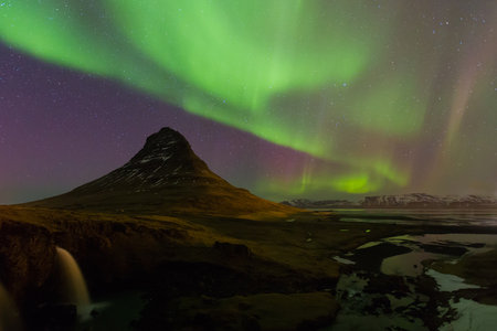 auroral: Beautiful northen lights over Kirkjufell mountain in Iceland with fully of star on sky Stock Photo