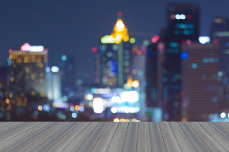 natual: Opening wooden floor, blurred bokeh lights aerial view city downtown night view Stock Photo