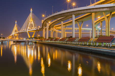 interchanged: Suspension bridge with highway interchanged at night with water reflection, Bangkok Thailand