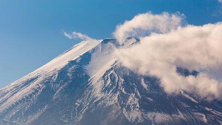 fuji mountain: Closed up peak of Fuji mountain with cloud covered on top