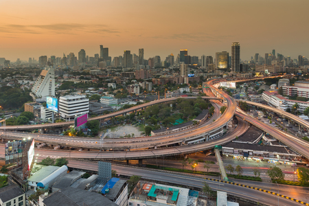 interchanged: City interchanged highway with downtown background during sunset Stock Photo