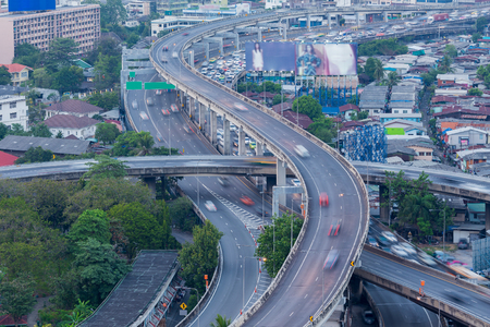 interchanged: Closed up highway interchanged with moving traffic before busy hours Stock Photo