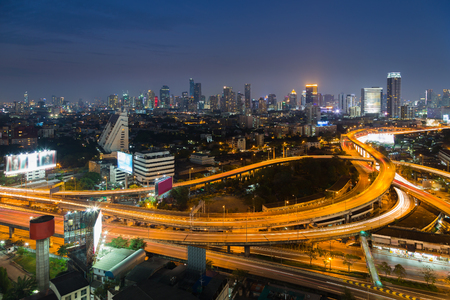 interchanged: Aerial view of highway interchanged with city downtown background night view Stock Photo