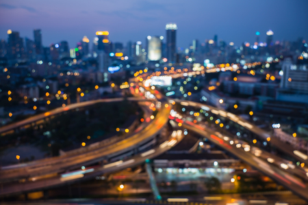 interchanged: Blurred bokeh lights interchanged with city downtown background Stock Photo