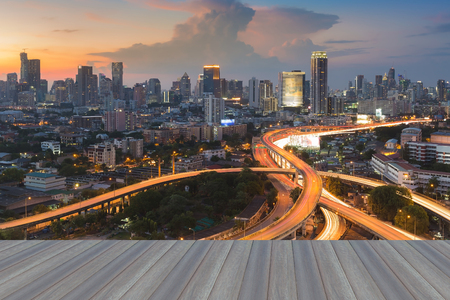 interchanged: Opening Wooden floor, City background with highway interchanged  during  sunset
