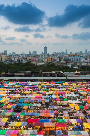 fleamarket: Twilight over city  downtown over multiple colors weekend market, Bangkok Thailand