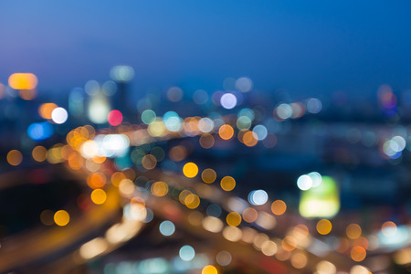 interchanged: Abstract blurred bokeh lights during city with road interchanged during twilight Stock Photo