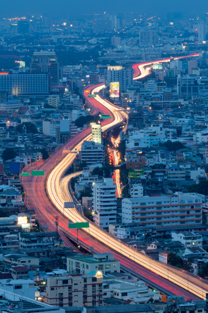 arial: Arial view city expressway long exposure during Twilight
