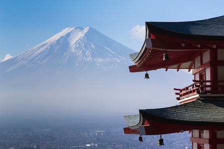 fuji san: Mt. Fuji viewed from behind red Chureito Pagoda, Japan during late winter Editorial