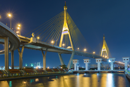 bridge over water: Twilight at twin suspension bridge over water gate (the Industrial Ring Road Bridge) in Thailand