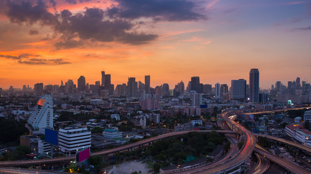 interchanged: Beauty of sunset over city downtown and highway interchanged