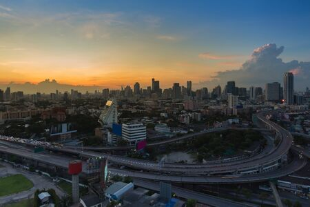 interchanged: Aerial view city downtown background and highway interchanged after sunset Stock Photo