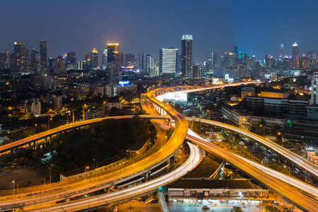 interchanged: Twilight, highway interchanged infrastructure and city downtown background