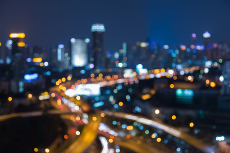 interchanged: Night blurred bokeh lights, city downtown background and highway interchanged