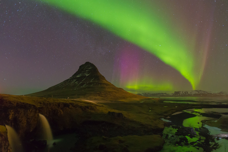 auroral: Kirkjufell mountain with beautiful northern lights and fully of star night view, Iceland