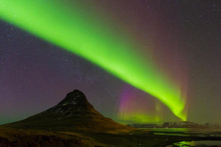 auroral: Aurora dancing over Kirkjufell mountain with fully of start night view