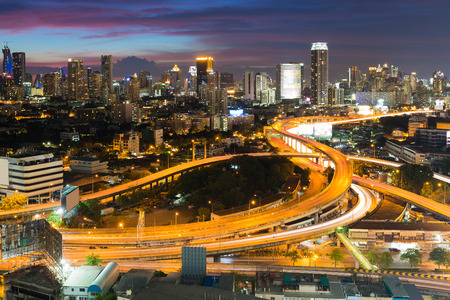 interchanged: Aerial view expressway interchanged with city downtown background night view