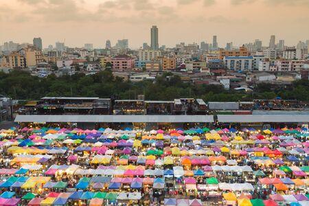 fleamarket: Aerial view over Bangkok city downtown flea market, multiple colours  roof top, Thailand